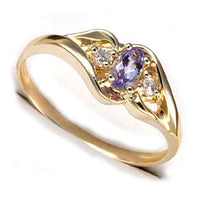 Genuine 4x6mm Oval Tanzanite and 10K Yellow Gold Band Ring Size 7 - Silver Insanity