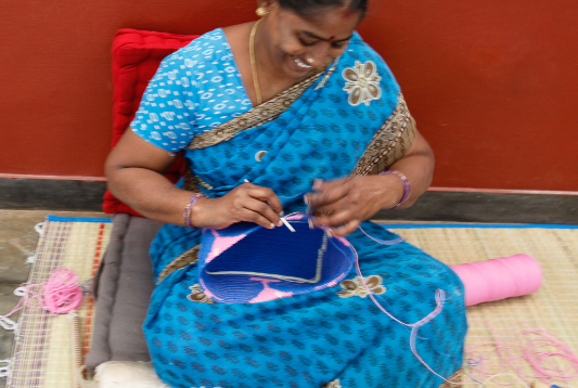 Skipping Girl Artisan making bags