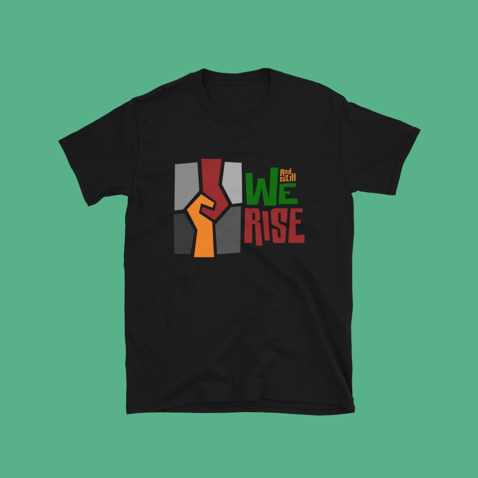 black cotton t-shirt with And Still We Rise exhibition logo