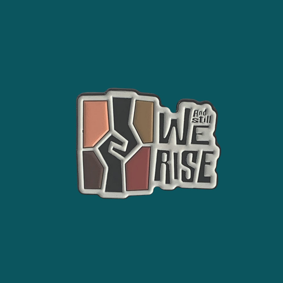 1.25 inch soft enamel lapel pin with the Ad Still We rise exhibition logo.