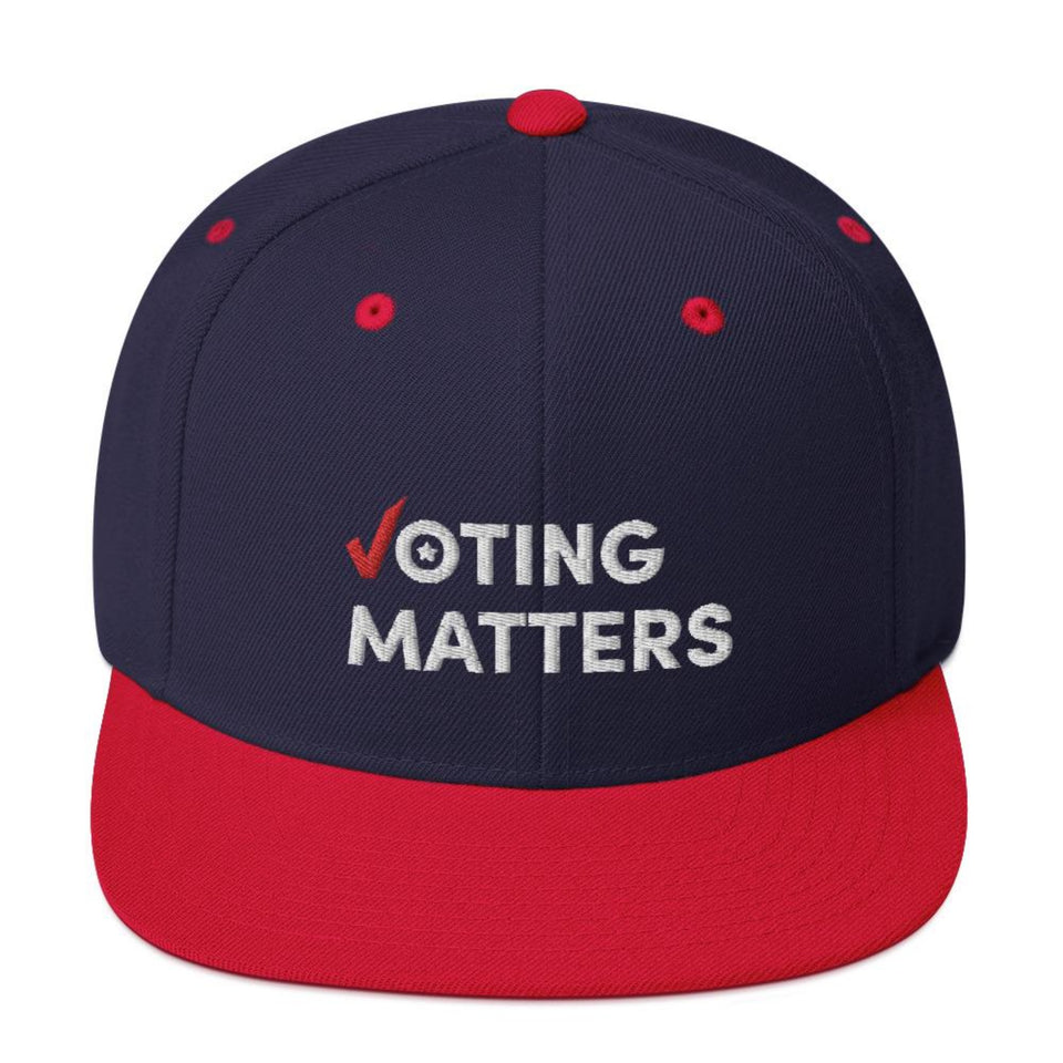 navy blue  with red brim snapback baseball style hat with Voting Matters lettered in white