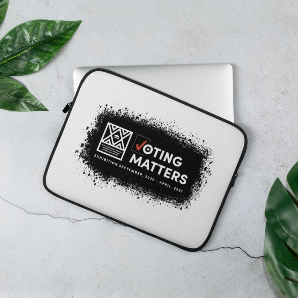 white computer laptop sleeve with Voting Matters exhibition logo