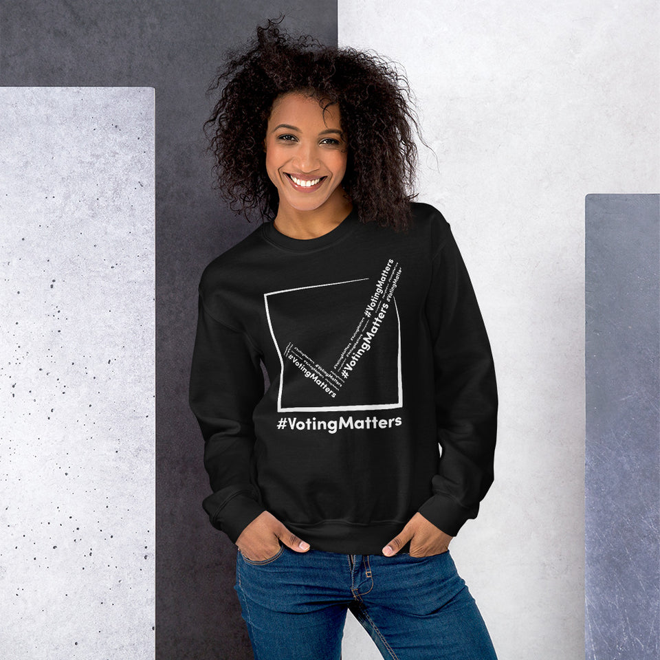 African American woman wearing black sweatshirt with white  hashtag voting matters logo on it