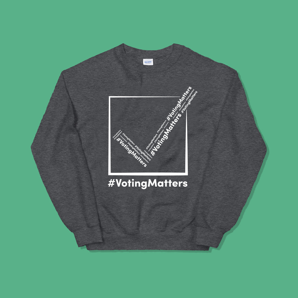 dark grey sweatshirt with hashtag voting matters logo on it with white lettering