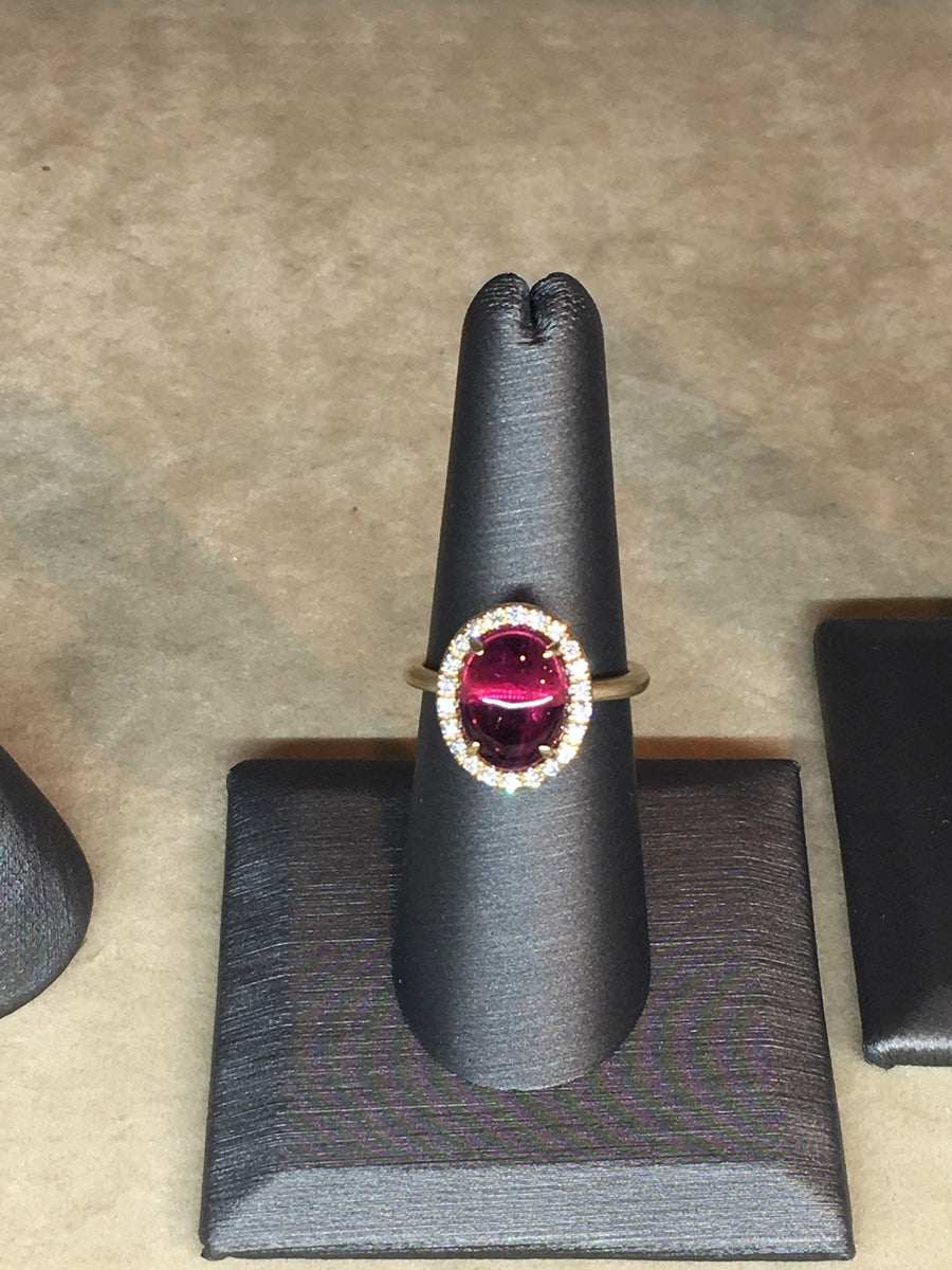 3 carat Rubelite Tourmaline Cabochon with diamond halo 14k gold ring