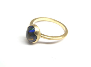 Black Welo Fire opal, 9x7mm, 18ky gold signature ring