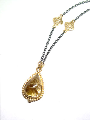 Rutilated Quartz 14k rich yellow gold and antiqued silver pendant