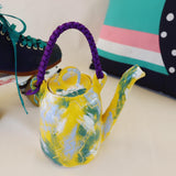 Pop yellow teapot