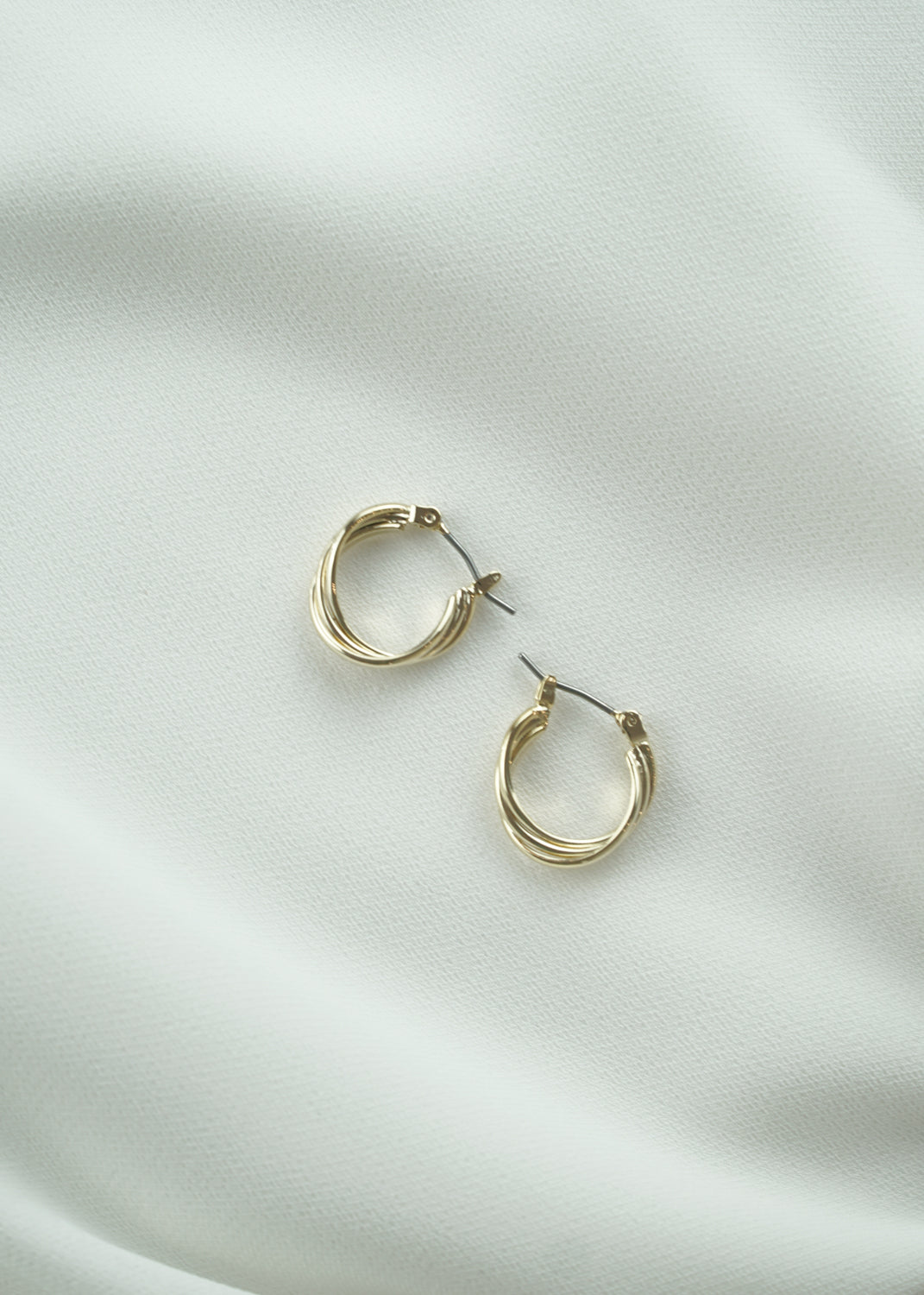 Twisted Golden Tiny Hoop Earrings