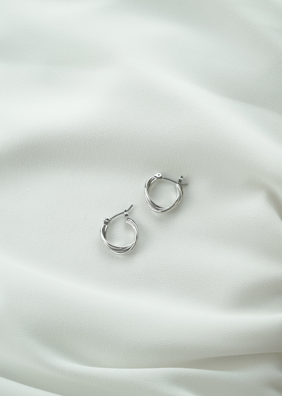 Twisted Silver Tiny Hoop Earrings