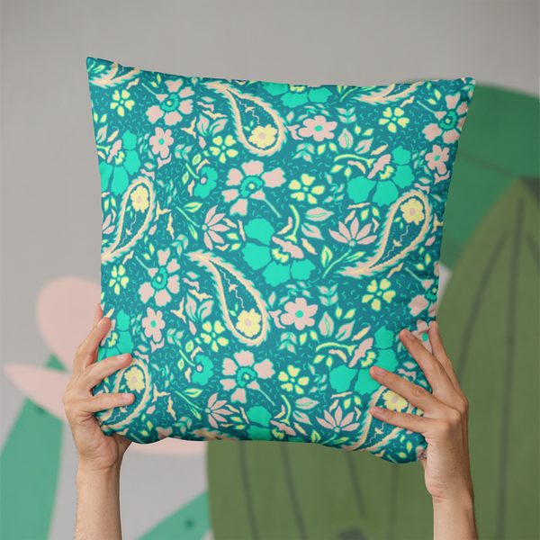 Bright Paisley with green tones on a throw pillow