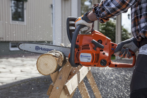 Husqvarna 120 Mark II chainsaw in use