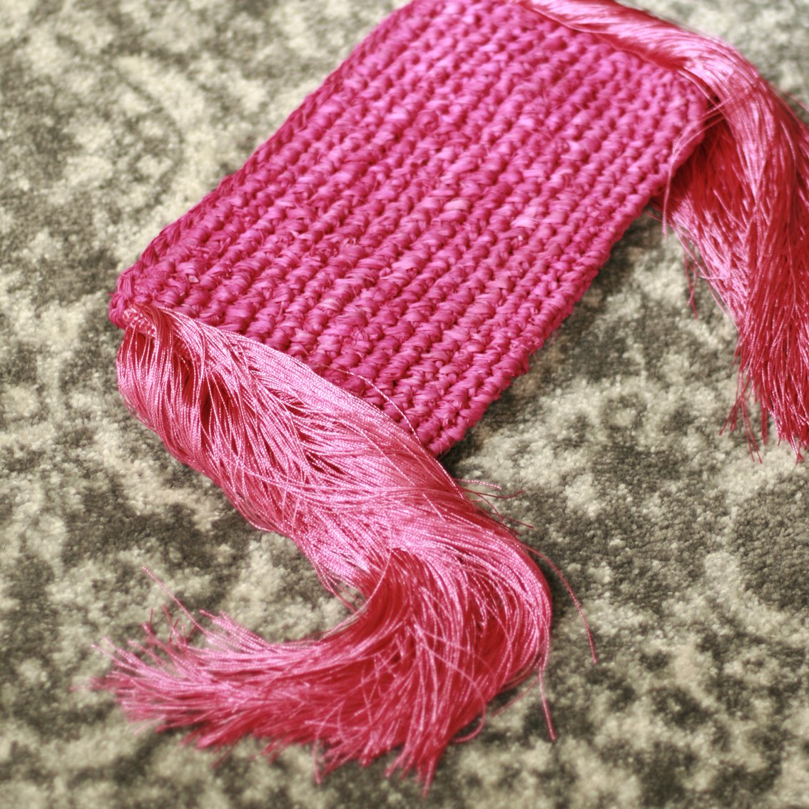 Canggu Fringe Raffia Straw Clutch, in Dragon Fruit Pink