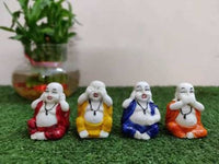 Luvcraft Colorful 4 Laughing Buddha Figurines - for Home Decor| Office Decor| Chrismas Decor| Diwali Decor| Vaastu Decor| Fengshui Decorative Showpiece - 6 cm  (Polyresin, Multicolor)