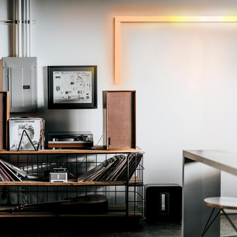 LIFX beam light bar in orange mounted to a contemporary office wall
