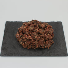 A patty of Beef Complete Mix all-natural raw dog food from Raw K9