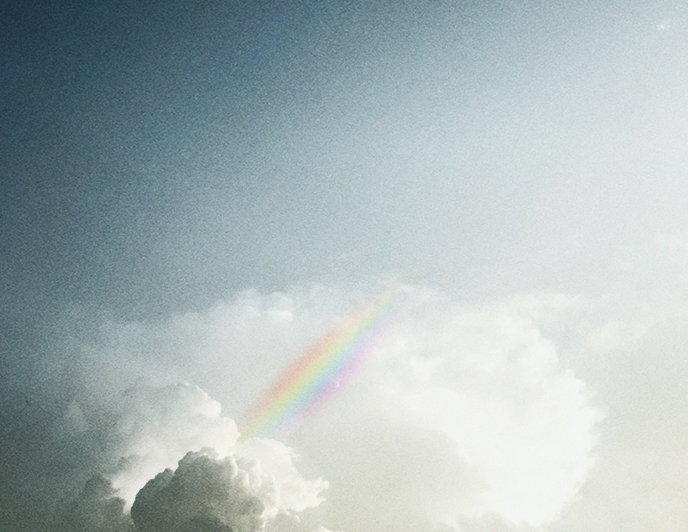 image of clouds and rainbow