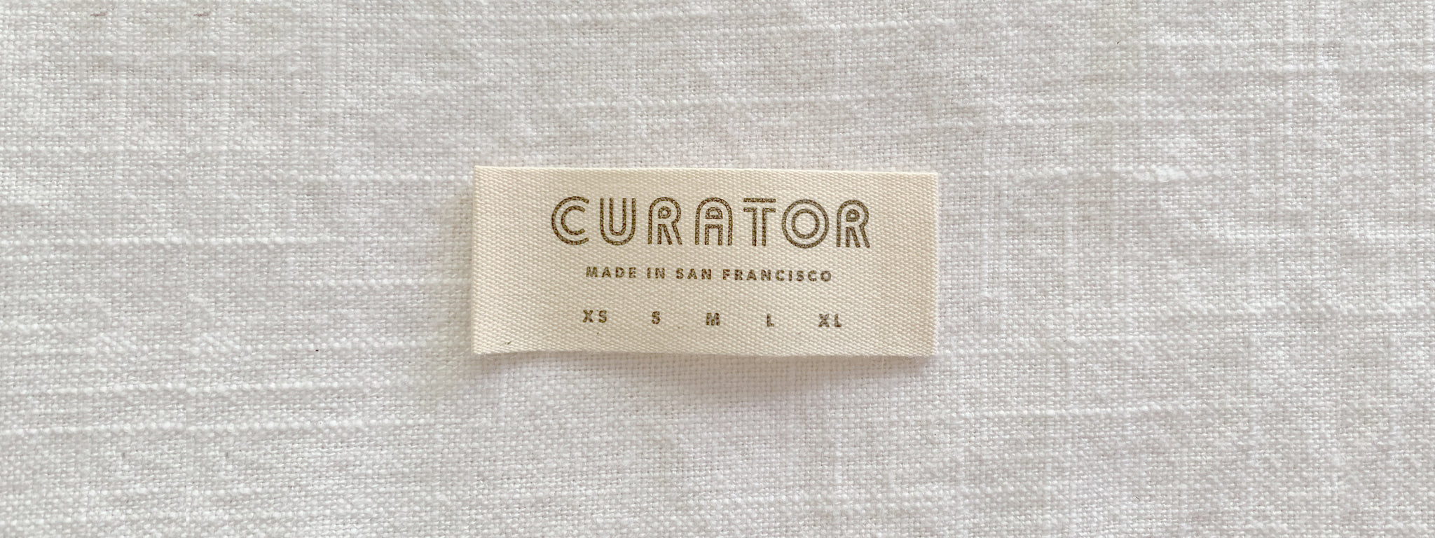 label with logo and sizes printed on it