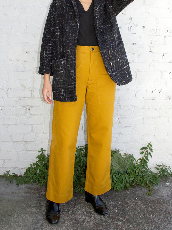 model with mustard yellow wide leg pants