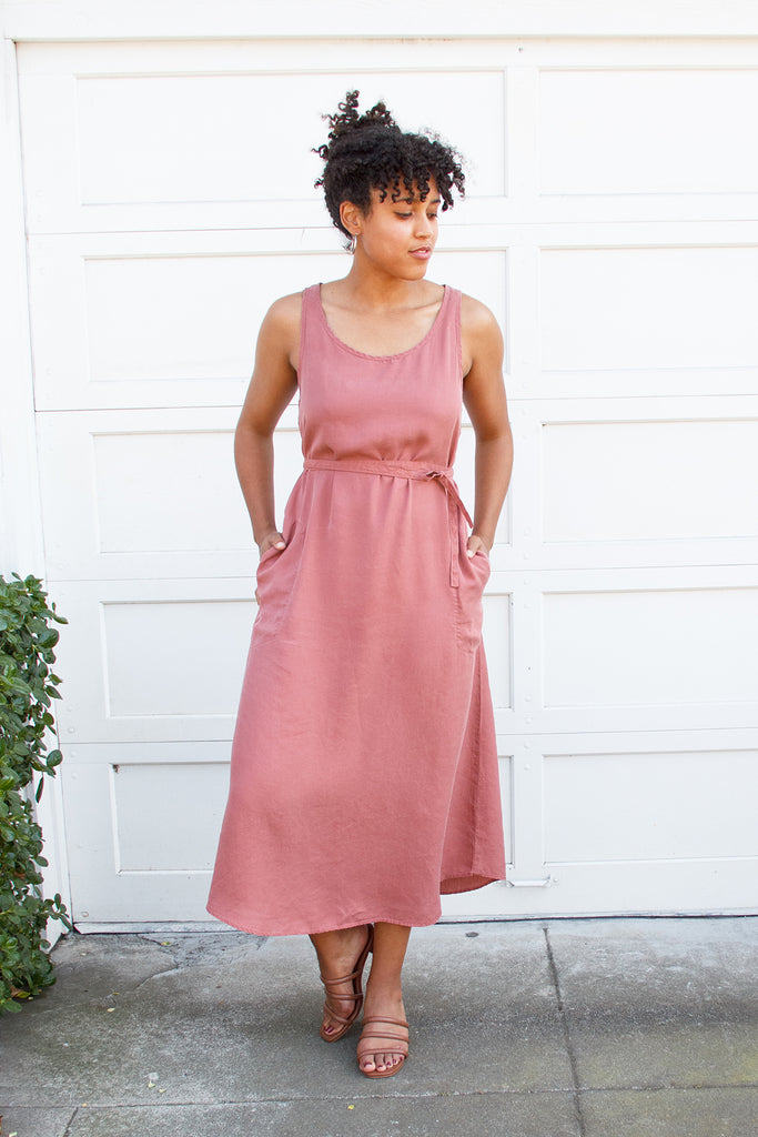 model in rose pink dress with pockets and tie waist