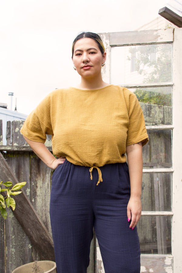 yellow cropped drawstring shirt on model