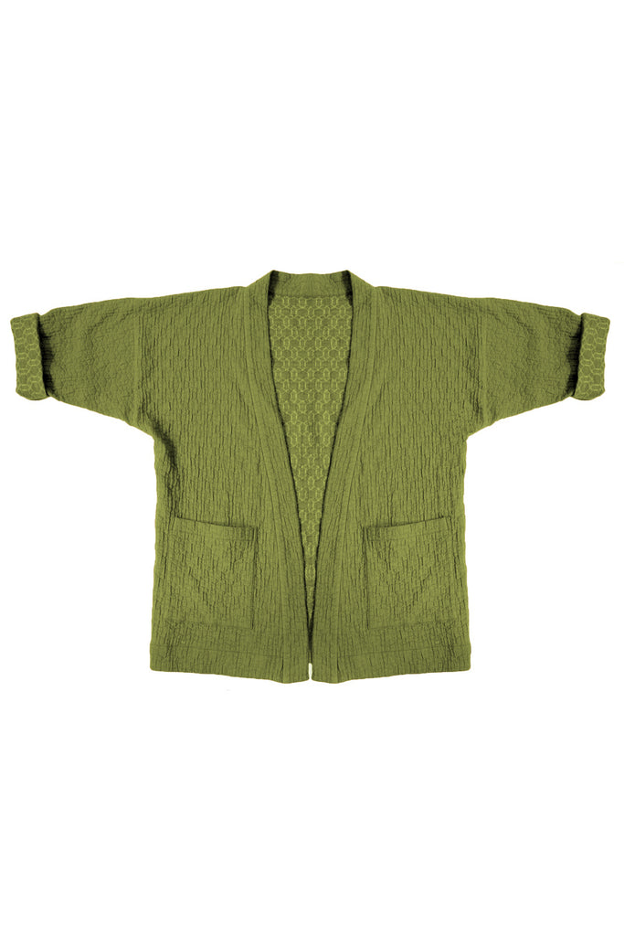 Green quilted jacket with front patch pockets on white background