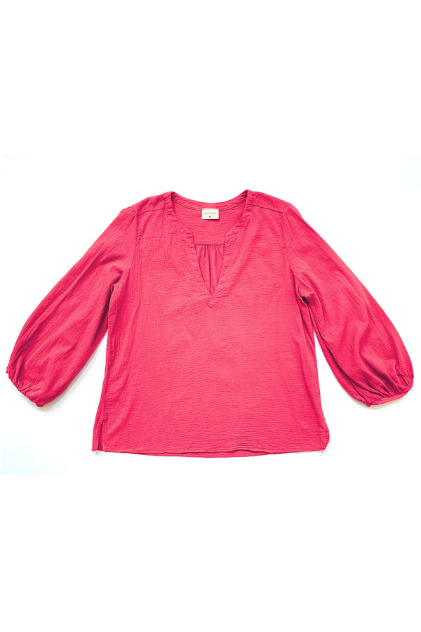 hot pink long sleeve blouse flat on white background