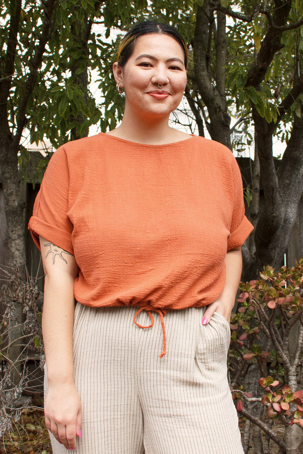 red orange cropped top on model