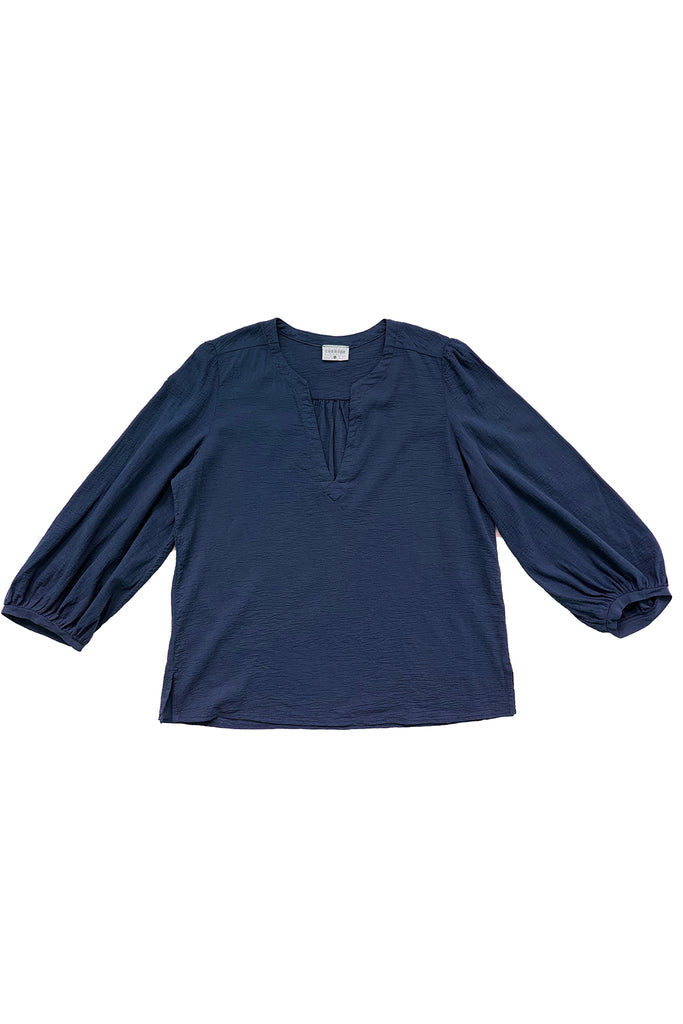 navy blue long sleeve blouse flat on white background