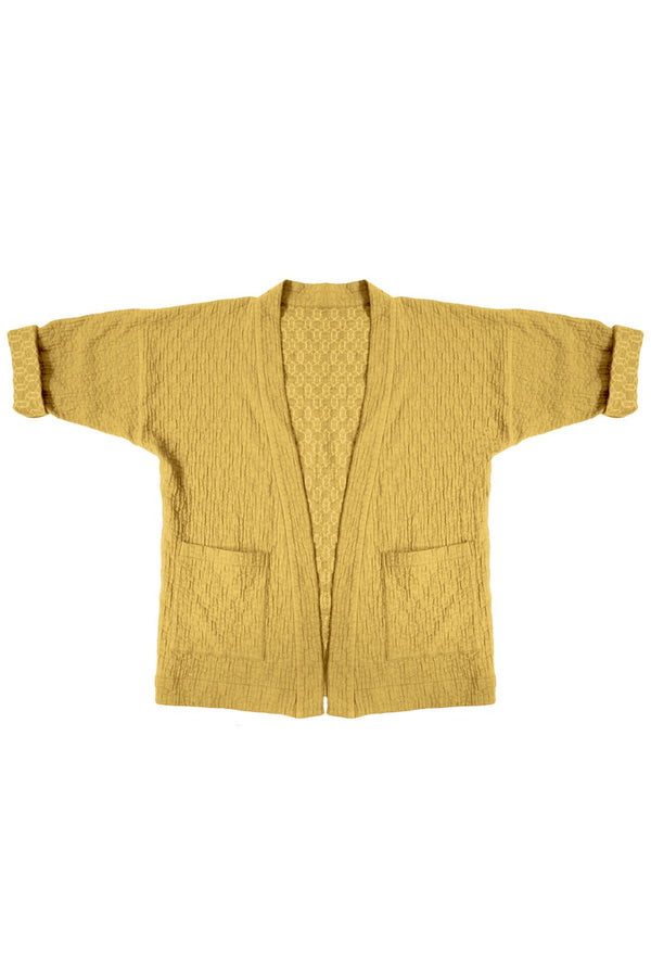 yellow quilted jacket with patch pockets on white background
