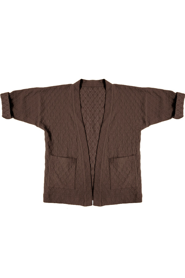 Brown quilted jacket with front patch pockets against white background