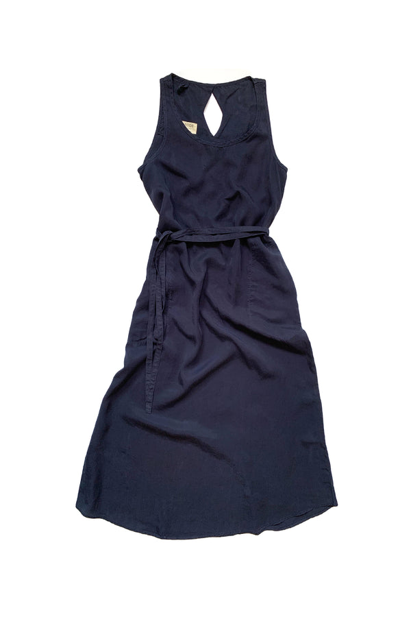 navy blue sleeveless dress with tied waist against white background