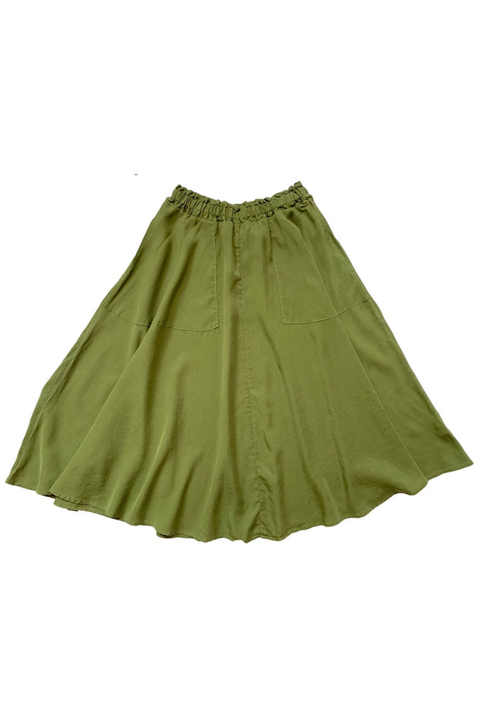 Bright green elastic waist skirt with pockets spread out on white background