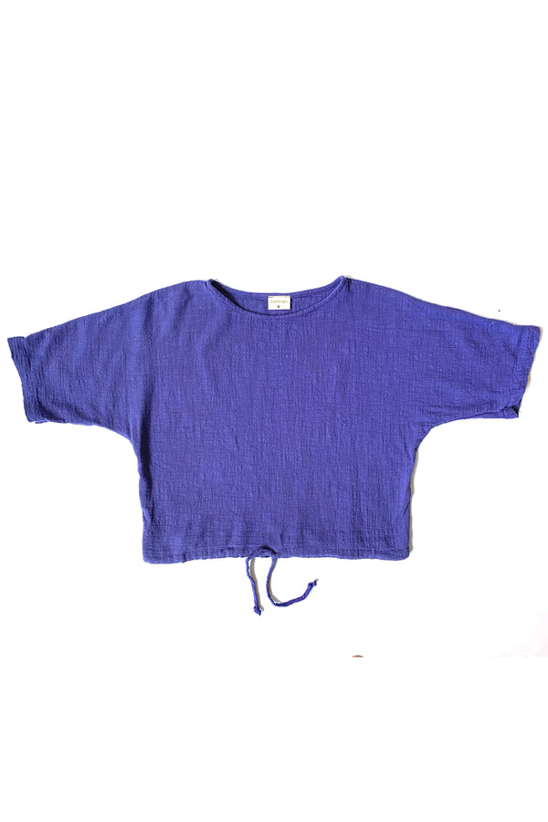 Purple lapis cropped shirt with drawstring on white background.