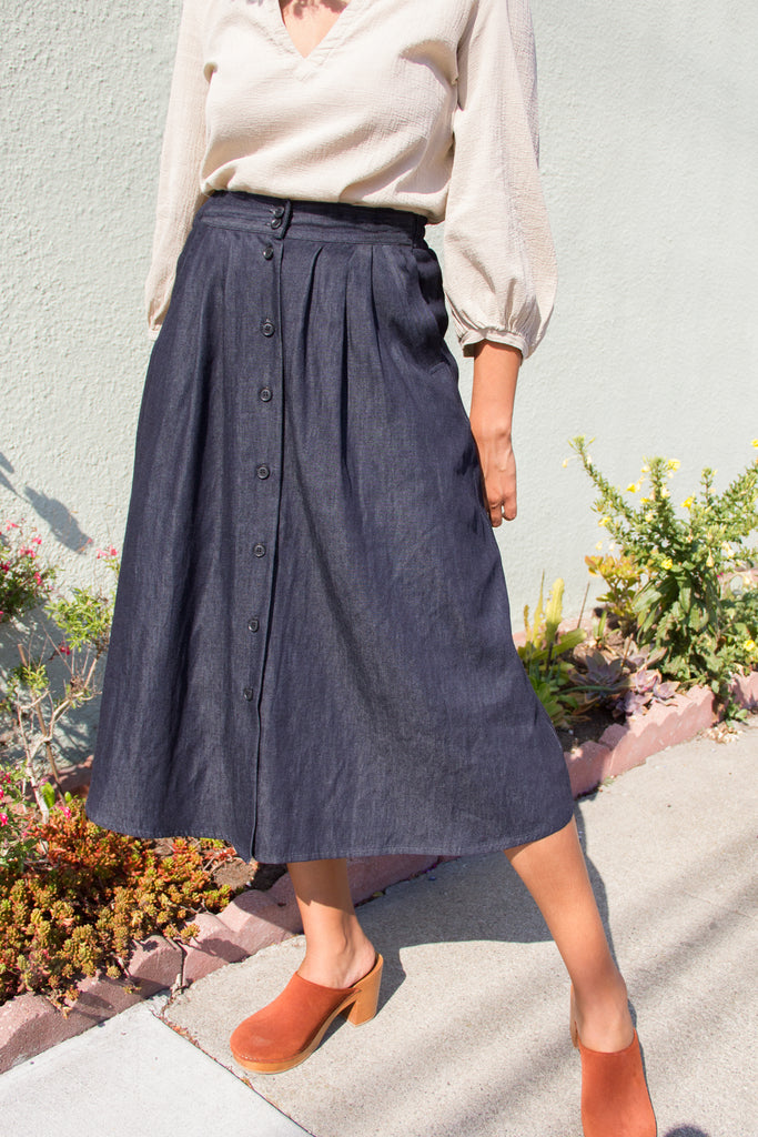 button front denim skirt on model