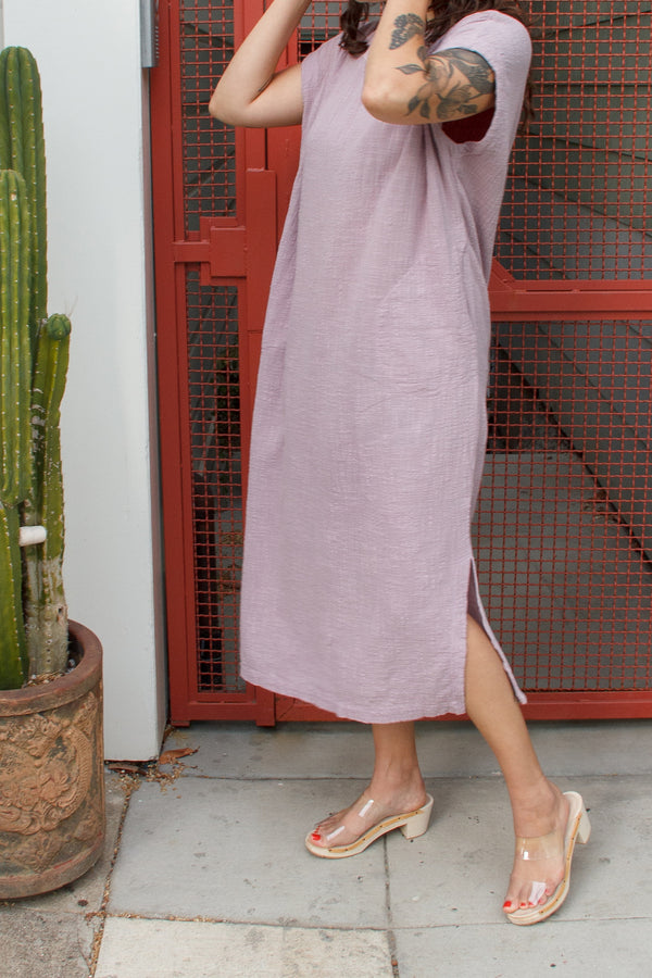 long lavender dress on model with clear shoes