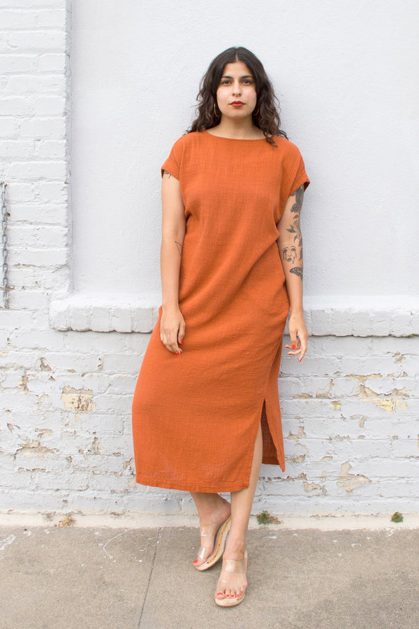 long rust colored dress on model