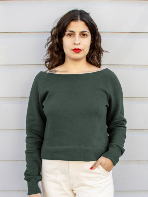 deep green boat neck sweatshirt on model
