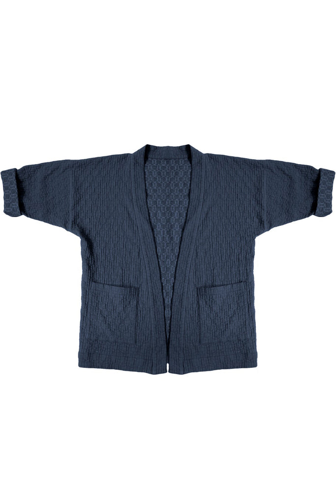 quilted jacket with front patch pockets in navy blue on white background