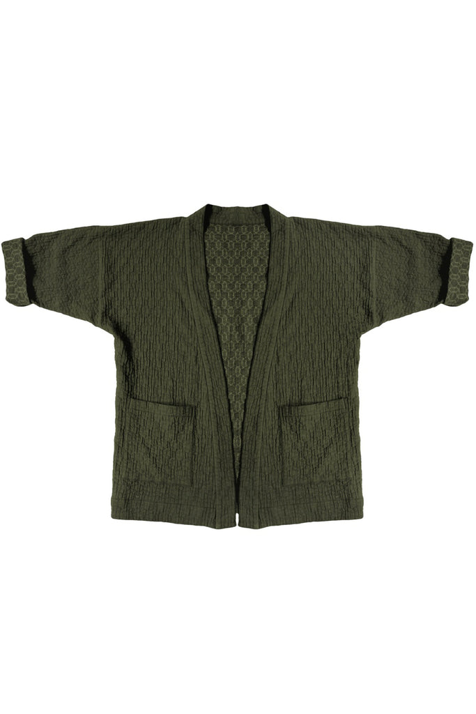 forest green quilted jacket with front patch pockets against white background