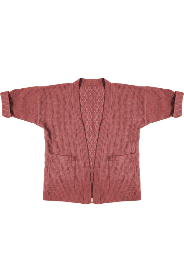 pink quilted jacket with patch pockets against white background