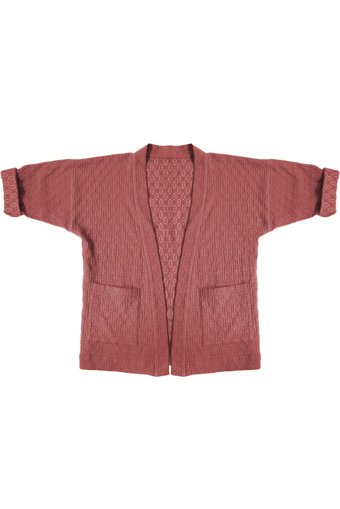pink quilted jacket with patch pockets