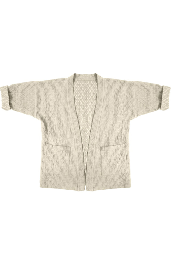 beige quilted jacket with front patch pockets on white background
