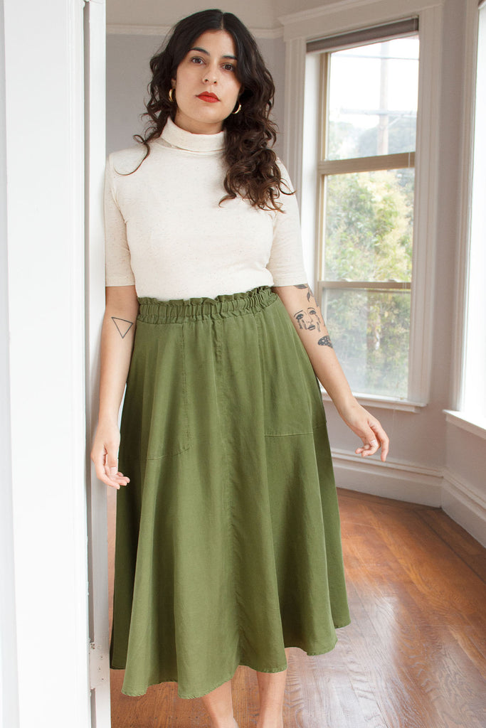 elastic waist green skirt on model