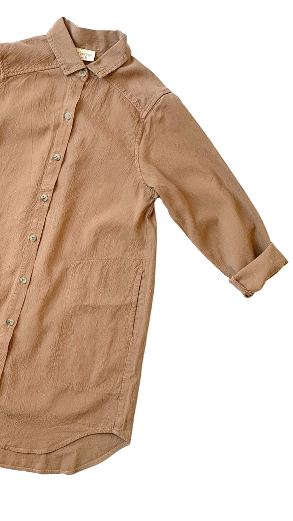 close up of button up collared shirt in camel tan