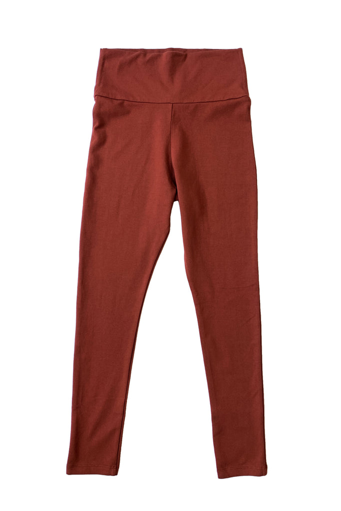Burnt red high waisted leggings against white background