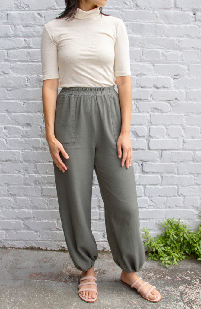 model in dusty green pants with elastic waist