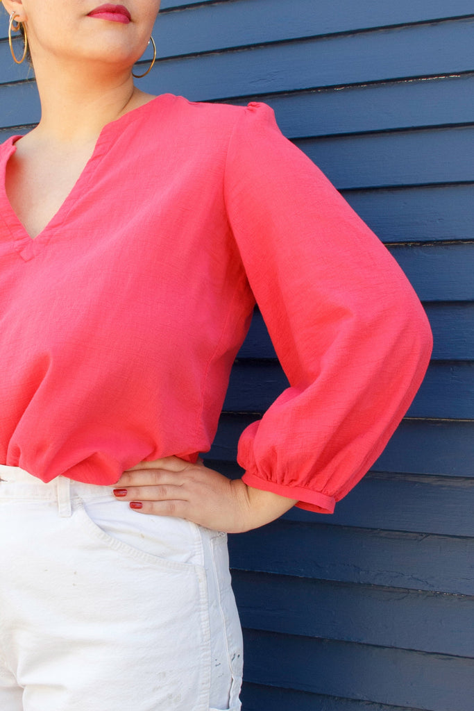 close up of long sleeve hot pink blouse