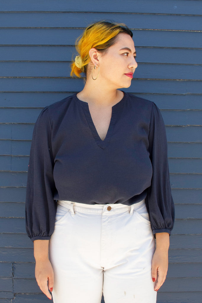 model in navy long sleeve blouse