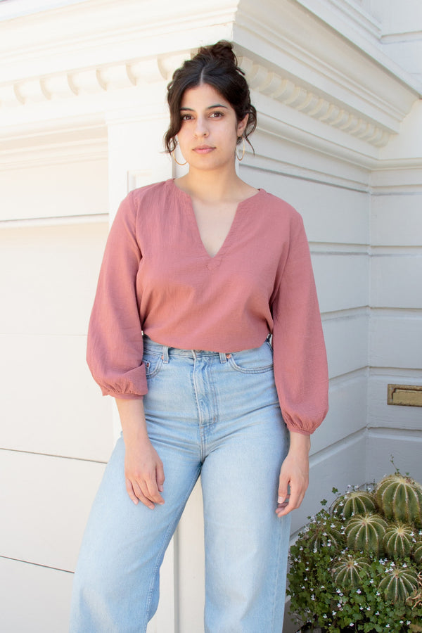 rose pink blouse on model